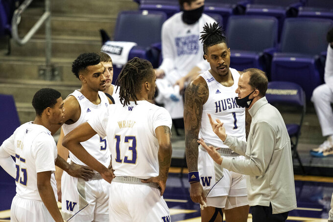 Washington coach Mike Hopkins calls his team together during a timeout as the Huskies struggled with Montana in the first half of an NCAA college basketball game, Wednesday, Dec. 16, 2020, at Alaska Airlines Arena in Seattle. (Dean Rutz/The Seattle Times via AP)