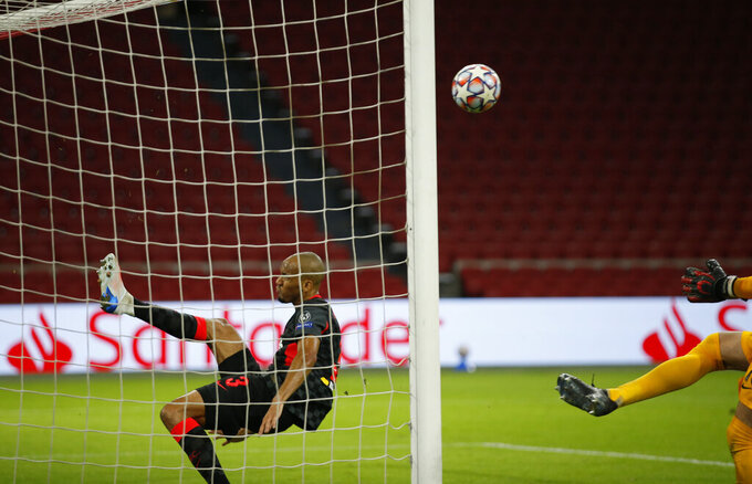 Liverpool's Fabinho, saves from the goal line after a header from Ajax's captain Dusan Tadic from scoring during the group D Champions League soccer match between Ajax and Liverpool at the Johan Cruyff ArenA in Amsterdam, Netherlands, Wednesday, Oct. 21, 2020. (AP Photo/Peter Dejong)