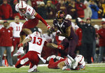 Minnesota running back Rodney Smith (1) breaks free from a tackle by Nebraska linebacker JoJo Domann (13) during an NCAA college football game Saturday, Oct. 12, 2019, in Minneapolis. (AP Photo/Stacy Bengs)