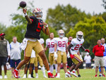 San Francisco 49ers quarterback Trey Lance practices during a 49ers and Los Angeles Chargers joint NFL football team practice in Costa Mesa, Calif., Friday, Aug. 20, 2021. (AP Photo/Damian Dovarganes)