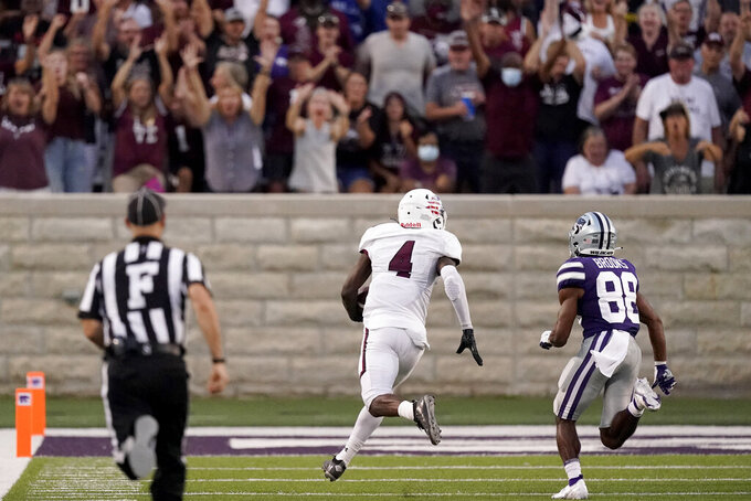 Southern Illinois cornerback PJ Jules (4) is chased into the end zone by Kansas State wide receiver Phillip Brooks (88) after intercepting a pass and running it back for a touchdown during the first half of an NCAA college football game, Saturday, Sept. 11, 2021, in Manhattan, Kan. (AP Photo/Charlie Riedel)