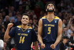 UC Irvine guard Evan Leonard (14) and forward Jonathan Galloway (5) celebrate after they defeated Kansas State in a first round men's college basketball game in the NCAA Tournament, Friday, March 22, 2019, in San Jose, Calif. (AP Photo/Chris Carlson)
