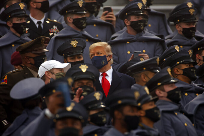 President Donald Trump watches an NCAA college football game with Army cadets during the Army-Navy NCAA college football game on Saturday, Dec. 12, 2020, in West Point, N.Y. (AP Photo/Adam Hunger)