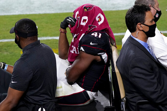 Arizona Cardinals running back Kenyan Drake is carted off the field after an injury against the Seattle Seahawks during the second half of an NFL football game, Sunday, Oct. 25, 2020, in Glendale, Ariz. (AP Photo/Ross D. Franklin)