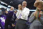 Northwestern University Athletic Director Jim Phillips celebrates as the Northwestern women's basketball team beats Illinois 75-58 to win at least a share of the Big Ten Conference Championship at Welsh-Ryan Arena Saturday, Feb. 29, 2020, in Evanston, Ill. The Atlantic Coast Conference is finalizing an deal to make Northwestern athletic director Jim Phillips the league's next commissioner. Two people with knowledge of the situation told The Associated Press they expected an agreement to be reached with Phillips and the conference soon.. (John J. Kim/Chicago Tribune via AP)