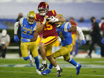 Southern California wide receiver Drake London runs to the end zone for a touchdown during the second quarter of an NCAA college football game against UCLA, Saturday, Dec 12, 2020, in Pasadena, Calif. (AP Photo/Ashley Landis)