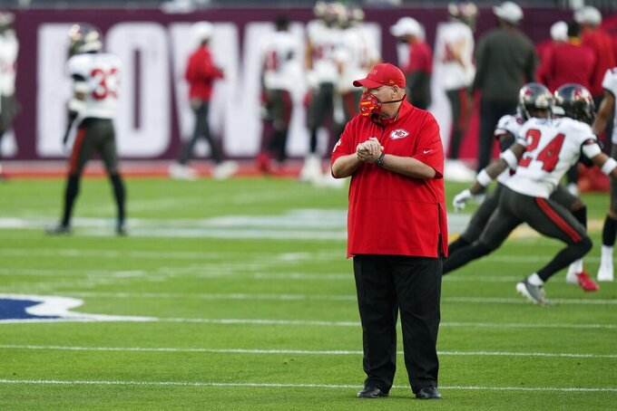 Kansas City Chiefs head coach Andy Reid stands on the field before the NFL Super Bowl 55 football game between the Kansas City Chiefs and Tampa Bay Buccaneers, Sunday, Feb. 7, 2021, in Tampa, Fla. (AP Photo/David J. Phillip)