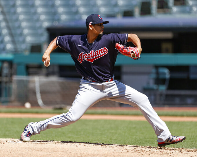 Cleveland Indians starting pitcher Carlos Carrasco pitches during baseball practice at Progressive Field, Monday, July 6, 2020, in Cleveland. (AP Photo/Ron Schwane)