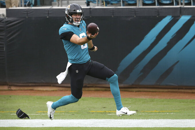 Jacksonville Jaguars quarterback Jake Luton celebrates after scoring a touchdown against the Houston Texans on a 16-yard run during the second half of an NFL football game, Sunday, Nov. 8, 2020, in Jacksonville, Fla. (AP Photo/Stephen B. Morton)