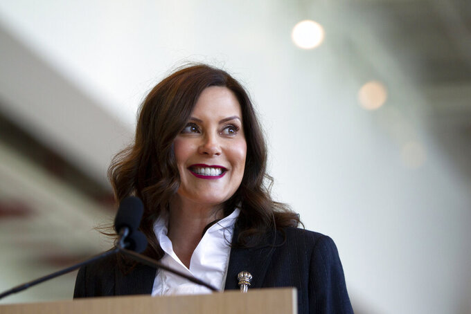 FILE - In this May 24, 2021 file photo, Gov. Gretchen Whitmer speaks at Steelcase in Grand Rapids, Mich. The Michigan Supreme Court on Friday, June 11 unanimously ordered the state elections board to certify a veto-proof initiative that would let Republican legislators wipe from the books a law Whitmer used to issue sweeping pandemic orders. (Cory Morse/The Grand Rapids Press via AP, File)