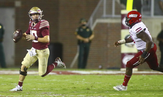Florida State quarterback McKenzie Milton (10) scrambles out of the pocket as he is chased by Jacksonville State defensive end Umstead Sanders (12) during the third quarter of an NCAA college football game Saturday, Sept. 11, 2021, in Tallahassee, Fla. Jacksonville State won 20-17. (AP Photo/Phil Sears)