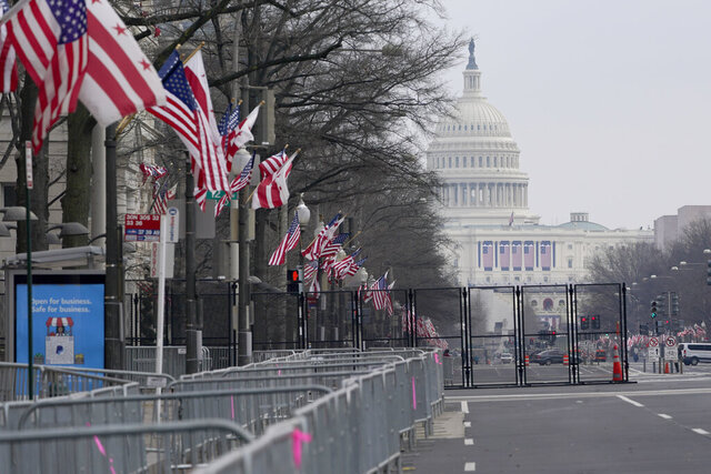 A view down Pennsylvania Avenue shows the security around the Capitol Hill in Washington, Friday, Jan. 15, 2021, ahead of the inauguration of President-elect Joe Biden and Vice President-elect Kamala Harris. Between the still-raging pandemic and suddenly very real threat of violence from supporters of outgoing President Donald Trump, Jan. 20 promises to be one of the most unusual presidential inaugurations in American history. Joe Biden and Kamala Harris will take the oath of office outside the Capitol. (AP Photo/Susan Walsh)