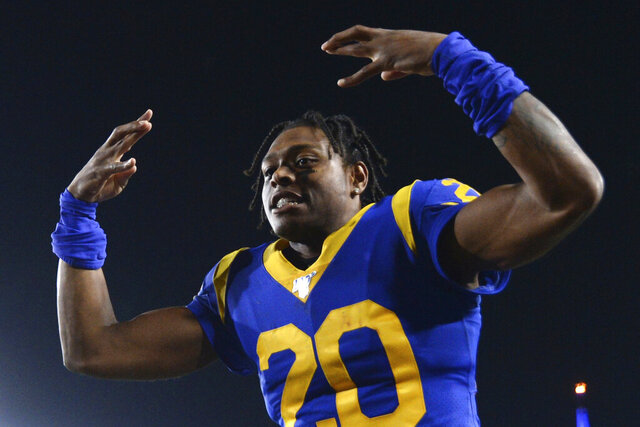 FILE - In this Nov. 17, 2019, file photo, Los Angeles Rams cornerback Jalen Ramsey celebrates the team's win over the Chicago Bears in an NFL football game in Los Angeles. Ramsey says he won't hold out as he heads into the final year of his rookie contract and his first full season with the Rams. After a tumultuous tenure in Jacksonville, the star cornerback sounds content in Los Angeles and eager to play new roles on defense. (AP Photo/Kyusung Gong, File)