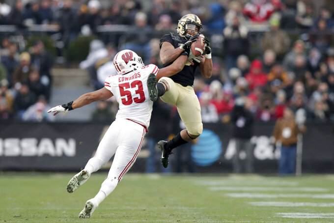 Purdue running back Markell Jones (8) makes a catch in front of Wisconsin linebacker T.J. Edwards (53) during the first half of an NCAA college football game in West Lafayette, Ind., Saturday, Nov. 17, 2018. (AP Photo/Michael Conroy)