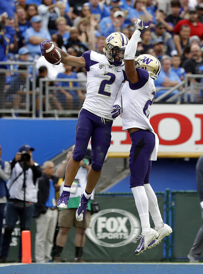 Washington wide receiver Aaron Fuller (2) celebrates his touchdown reception with teammate Quinten Pounds during the first half of an NCAA college football game Saturday, Oct. 6, 2018, in Pasadena, Calif. (AP Photo/Marcio Jose Sanchez)