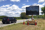 Drivers on Connecticut Route 2, in Preston, Conn., Monday, June 1, 2020, pass one of four electronic signs erected Sunday night by the state to warn patrons of Foxwoods Resort Casino and Mohegan Sun about the potential dangers of being a large crowd and urging them not to