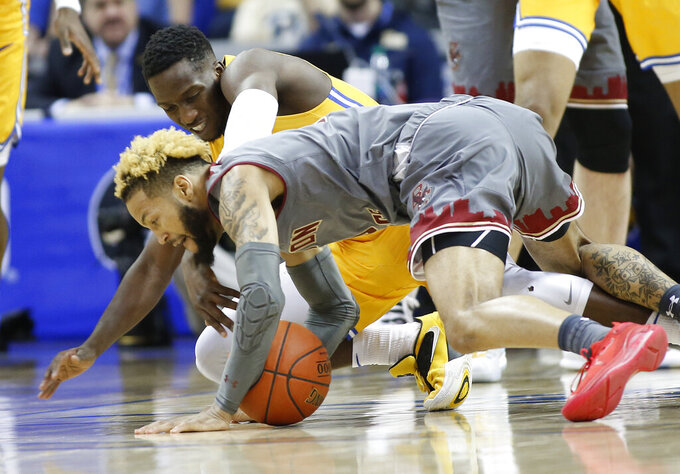 Boston College's Ky Bowman, front and Pittsburgh's Sidy N'Dir, back, compete for a loose ball during the first half of an NCAA college basketball game in the Atlantic Coast Conference men's tournament in Charlotte, N.C., Tuesday, March 12, 2019. (AP Photo/Nell Redmond)