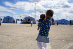 Afghan refugees in an Italian Red Cross refugee camp, in Avezzano, Italy, Tuesday, Aug. 31, 2021. This quarantine camp in Abruzzo, central Italy, where 1,250 migrants are hosted, is expected to close in a week as the quarantine expires and they are moved to other structures to apply for asylum. (AP Photo/Andrew Medichini)