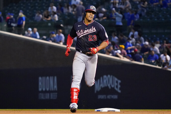 Washington Nationals' Juan Soto rounds the bases after hitting a solo home run during the fifth inning of a baseball game against the Chicago Cubs in Chicago, Wednesday, May 19, 2021. (AP Photo/Nam Y. Huh)