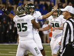 South Florida's Coby Weiss, center, celebrates with teammates Jacob Mathis (85) and Trent Schneider (39) after kicking the go-ahead field goal in an NCAA college football game against Tulsa in Tulsa, Okla., Friday, Oct. 12, 2018. (AP Photo/Sue Ogrocki)