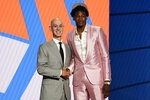 Kai Jones poses for a photo with NBA Commissioner Adam Silver after being selected as the 19th overall pick by the New York Knicks during the NBA basketball draft, Thursday, July 29, 2021, in New York. (AP Photo/Corey Sipkin)