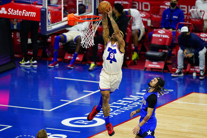 Philadelphia 76ers' Rayjon Tucker (9) goes up for a dunk against Orlando Magic's Cole Anthony (50) during the second half of an NBA basketball game, Sunday, May 16, 2021, in Philadelphia. (AP Photo/Matt Slocum)