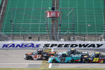 Chandler Smith (51) takes the green flag with Ben Rhodes (99), Sheldon Creed (2) and Brett Moffitt (23) during a NASCAR Truck Series auto race at Kansas Speedway in Kansas City, Kan., Saturday, Oct. 17, 2020. (AP Photo/Orlin Wagner)