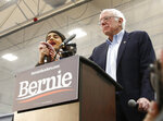 Democratic presidential candidate Sen. Bernie Sanders I-Vt., has his remarks interrupted by a protestor, left, during his campaign event in Carson City, Nev.., Sunday, Feb. 16, 2020. (AP Photo/Rich Pedroncelli)