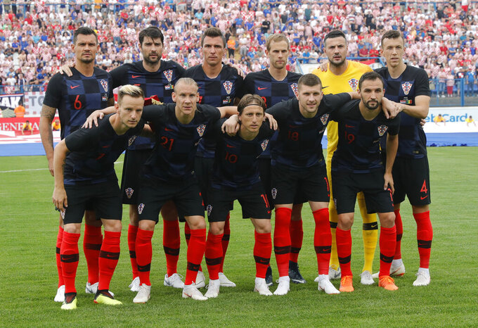 FILE - In this Friday, June 8, 2018 file photo, Croatia squad pose ahead of a friendly soccer match between Croatia and Senegal in Osijek, Croatia. Delaying the European Championship by a year has helped out some teams and hurt others. England had more time to integrate talented young players and deepen its squad. Croatia's squad from its run to the World Cup final in 2018 is nearing the end and Ivan Rakitic has retired from international soccer. (AP Photo/Darko Bandic, File)