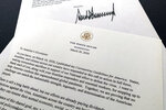 A letter from President Donald Trump to the nation's governors is photographed Thursday, March 26, 2020. Trump says that federal officials are developing guidelines to rate counties by risk of virus spread and that he wants to begin easing nationwide guidelines meant to stem the coronavirus outbreak. In the letter, Trump says the new guidelines are meant to enable state and local leaders to make