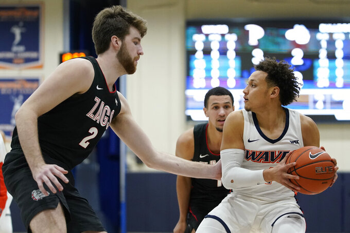 Gonzaga forward Drew Timme (2) defends against Pepperdine guard Colbey Ross (4) during the first half of an NCAA college basketball game Saturday, Jan. 30, 2021, in Malibu, Calif. (AP Photo/Ashley Landis)