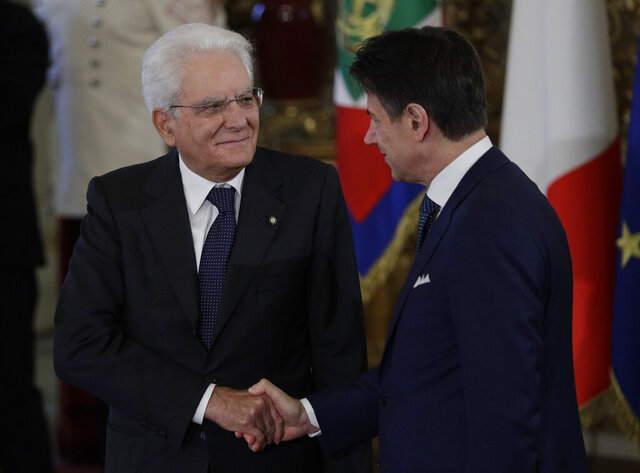FILE - In this Sept. 5, 2019 file photo, Italian President Sergio Mattarella, left, shakes hands with Prime Minister Giuseppe Conte during the swearing-in ceremony at the Quirinale Presidential Palace, in Rome. Italian Premier Conte was meeting Tuesday, Jan. 26. 2021 with his cabinet before heading to the presidential palace to offer his resignation after a key coalition ally pulled his party's support over Conte's handling of the coronavirus pandemic.  (AP Photo/Andrew Medichini, file)