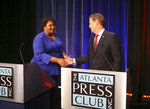 Democrat candidate for Georgia Governor Stacey Abrams and Republican Secretary of State Brian Kemp greet each other before a debate Tuesday, Oct. 23, 2018, in Atlanta. (AP Photo/John Bazemore)