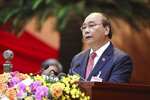 Vietnam Prime Minister Nguyen Xuan Phuc delivers a speech during the opening of 13th Communist Party Congress in Hanoi, Vietnam on Tuesday, Jan. 26, 2021. Vietnam's ruling Communist Party has begun a crucial weeklong meeting in the capital Hanoi to set the nation's path for the next five years and appoint the country's top leaders. (Bui Doan Tan/VNA via AP)