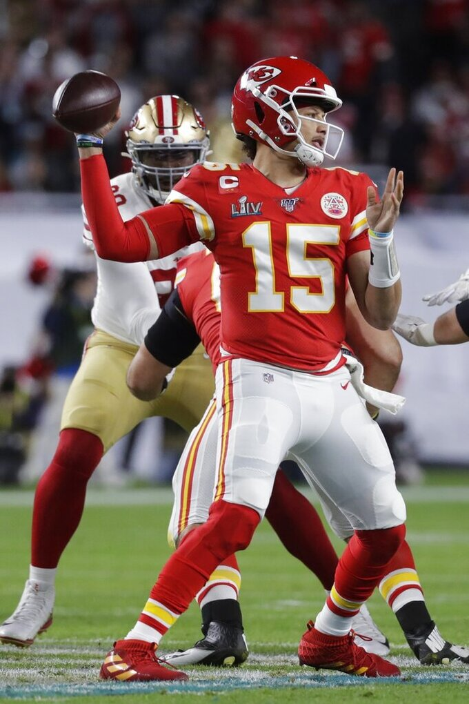 Kansas City Chiefs quarterback Patrick Mahomes (15) passes against the San Francisco 49ers during the first half of the NFL Super Bowl 54 football game Sunday, Feb. 2, 2020, in Miami Gardens, Fla. (AP Photo/Wilfredo Lee)