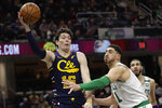 Cleveland Cavaliers' Cedi Osman, left, passes against Boston Celtics' Enes Kanter in the second half of an NBA basketball game, Wednesday, March 4, 2020, in Cleveland. Boston won 112-106. (AP Photo/Tony Dejak)