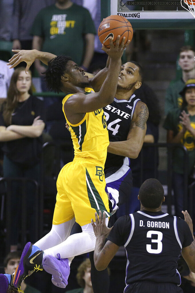 Baylor guard Davion Mitchell (45) attempts a shot in front of Kansas State forward Levi Stockard III (34) in the first half of an NCAA college basketball game, Tuesday, Feb. 25, 2020, in Waco, Texas. (AP Photo/ Jerry Larson)