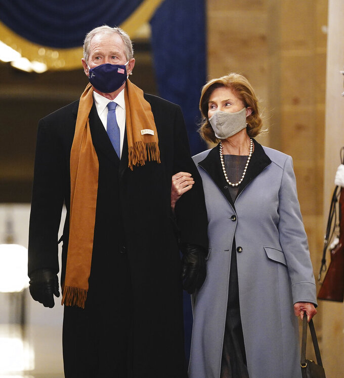Former President George W. Bush and Laura Bush arrive in the Crypt of the US Capitol for President-elect Joe Biden's inauguration ceremony on Wednesday, Jan. 20, 2021 in Washington. (Jim Lo Scalzo (Jim Lo Scalzo/Pool Photo via AP)