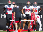San Francisco 49ers defensive tackle Javon Kinlaw (99), left, and San Francisco 49ers defensive end Nick Bosa (97) wait their turn to runs a drill during NFL Training Camp practice Saturday, Aug. 15, 2020, at the SAP Performance Facility in Santa Clara, Calif. (Xavier Mascarenas/The Sacramento Bee via AP)