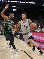 San Antonio Spurs' Bryn Forbes (11) drives against Boston Celtics' Kemba Walker during the first half of an NBA basketball game, Saturday, Nov. 9, 2019, in San Antonio. (AP Photo/Darren Abate)