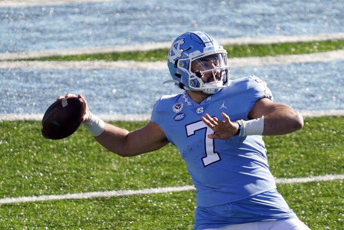 North Carolina quarterback Sam Howell (7) passes against Western Carolina during the first half of an NCAA college football game in Chapel Hill, N.C., Saturday, Dec. 5, 2020. (AP Photo/Gerry Broome)