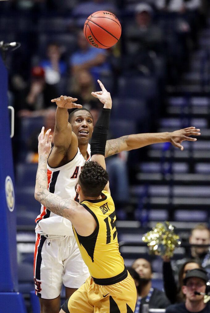 Missouri guard Jordan Geist (15) shoots against Auburn forward Horace Spencer in the second half of an NCAA college basketball game at the Southeastern Conference tournament Thursday, March 14, 2019, in Nashville, Tenn. Auburn won 81-71. (AP Photo/Mark Humphrey)