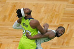 Minnesota Timberwolves forward Josh Okogie (20) fights for rebounding position with Boston Celtics guard Kemba Walker, right, in the second half of an NBA basketball game, Friday, April 9, 2021, in Boston. (AP Photo/Elise Amendola)