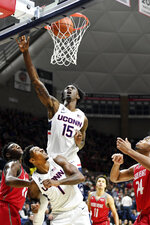 Connecticut's Sidney Wilson (15) shoots over teammate Christian Vital (1) in the first half of an NCAA college basketball game against Sacred Heart, Friday, Nov. 8, 2019, in Storrs, Conn. (AP Photo/Stephen Dunn)