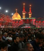 Shiite Muslim worshippers gather around the holy shrine of Imam Hussein, in the background, ahead of the Arbaeen festival in Karbala, Iraq, Friday, Oct. 18, 2019. The holiday marks the end of the forty day mourning period after the anniversary of the martyrdom of Imam Hussein, the Prophet Muhammad's grandson in the 7th century. (AP Photo/Hadi Mizban)