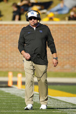 Kentucky head coach Mark Stoops watches play during the first half of an NCAA college football game against Missouri, Saturday, Oct. 27, 2018, in Columbia, Mo. (AP Photo/Charlie Riedel)