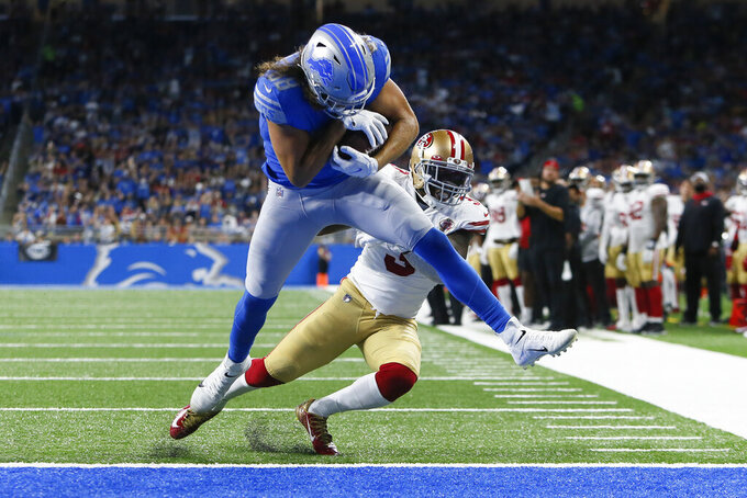 Detroit Lions tight end T.J. Hockenson (88) breaks the tackle of San Francisco 49ers safety Jaquiski Tartt (3) for a six yard touchdown reception in the first half of an NFL football game in Detroit, Sunday, Sept. 12, 2021. (AP Photo/Duane Burleson)