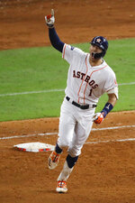Houston Astros' Carlos Correa celebrates after his walk-off home run against the New York Yankees during the 11th inning in Game 2 of baseball's American League Championship Series Sunday, Oct. 13, 2019, in Houston. (AP Photo/Sue Ogrocki)