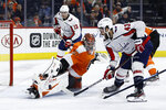 Philadelphia Flyers' Carter Hart (79) blocks a shot by Washington Capitals' Tom Wilson (43) during the third period of an NHL hockey game, Wednesday, Nov. 13, 2019, in Philadelphia. Washington won 2-1 in a shootout. (AP Photo/Matt Slocum)