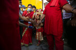 Nepal's revered living god Bhairabh walks towards a chariot during the annual Indra Jatra festival in Kathmandu, Nepal, Sunday, Sept. 19, 2021. The feast of Indra Jatra marks the return of the festival season in the Himalayan nation two years after it was scaled down because the pandemic. (AP Photo/Niranjan Shrestha)